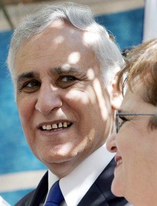 Israeli President Moshe Katzav greets we