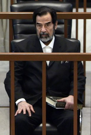 IMAGE: Saddam Hussein in court