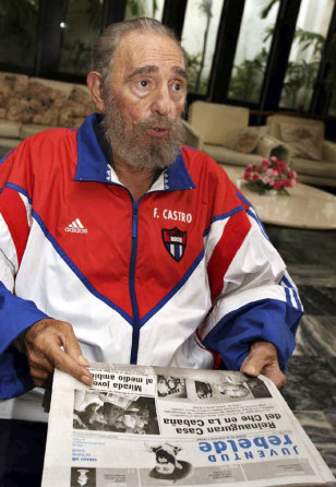 Cuba's President Castro holds local Saturday newspaper in Havana