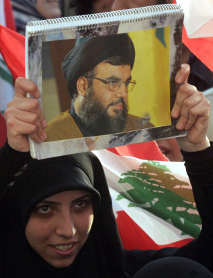 IMAGE: Protester holds picture of Nasrallah