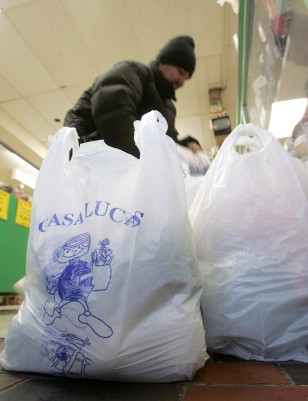 IMAGE: SHOPPER WITH PLASTIC BAGS