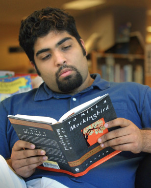 Image: Luis Banuelos reading