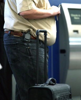 Image: Overweight traveler