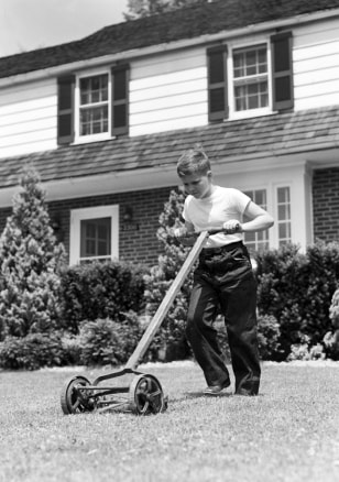 Image: Boy mowing lawn