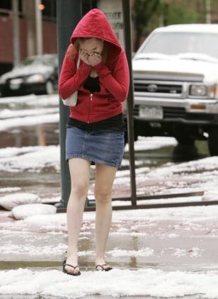IMAGE: Woman in flip-flops walks in hail
