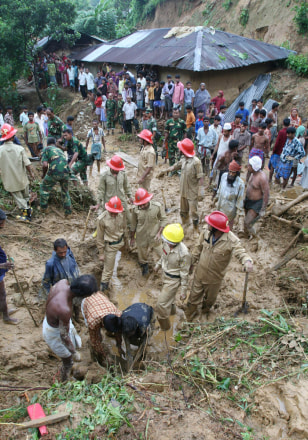 IMAGE: RESCUE WORKERS IN MUD