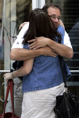 Image: American Home Mortgage workers hug