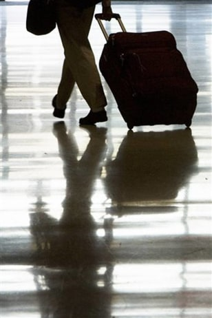 Image: A person rolling luggage
