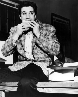 Image: Elvis eating a sandwich in Memphis in 1958.