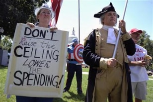 Image: Dozens of Tea Party supporters rally near the U.S. Capitol against raising the debt limit in Washington