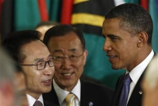 Image: President Barack Obama talks with South Korean President Lee Myung-bak and U.N. Secretary General Ban Ki-moon