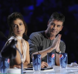 "Image: ""X Factor"" judges Paula Abdul and Simon Cowell."