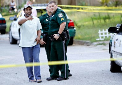 Image: A witness speaks with investigators in Gainesville, Fla.
