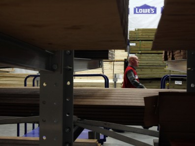 Image: An employee at a Lowe's store in Massachusettes
