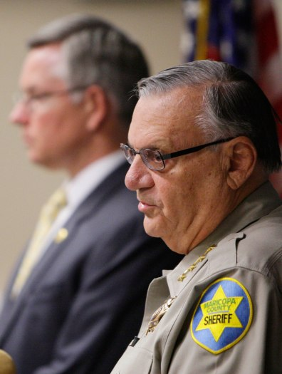 Image: Maricopa County Sheriff Joe Arpaio, right, with Maricopa County Attorney Bill Montgomery, announce at a news conference that a Maricopa County Sheriff's deputy and two detention officers have been arrested.