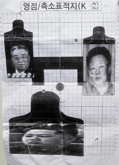 Image: A firing target depicting North Korea's founder's family.
