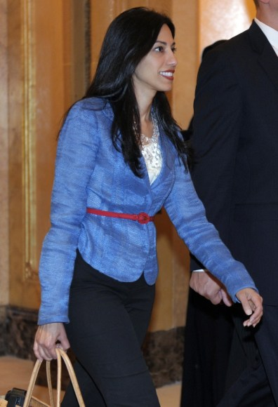 Image: Huma Abedin, an aide to U.S. Secretary of State Hillary Clinton, heads to a meeting in Abu Dhabi