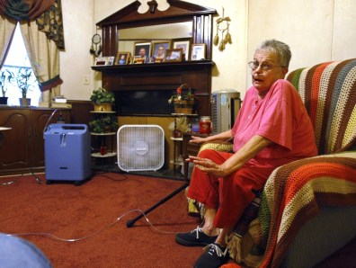 Image: Elderly woman with new fan in her home