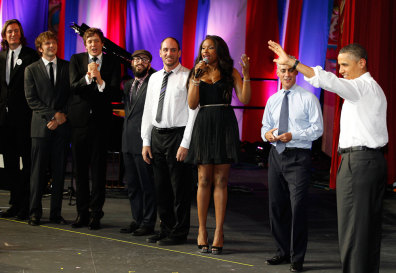 "Image: US President Obama listens as performers sing ""Happy Birthday"" to him"