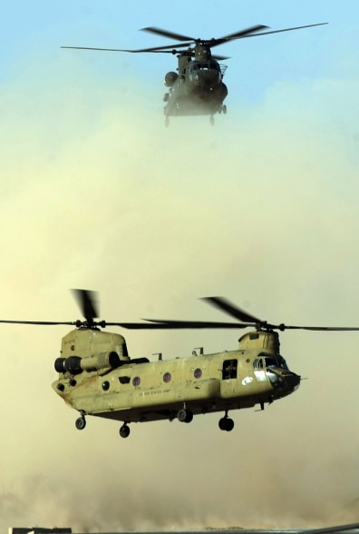 Image: Two U.S. army Chinook helicopters land at Kandahar airfield in March 2011
