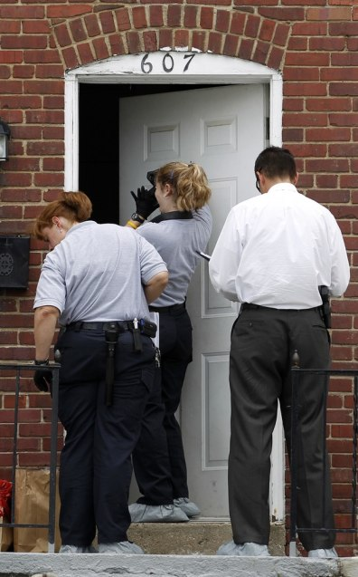Image: Police officers and crime lab investigators in Maryland