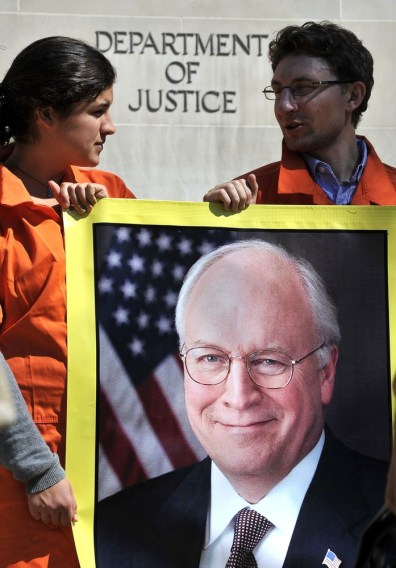 Image: Activists representing Amnesty International hold banner bearing portrait of former Vice President Dick Cheney