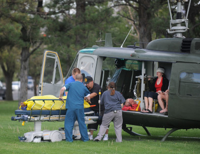 Image: Medics help injured bystanders out of a helicopter into Renown Medical Center