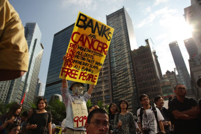 Image: A man holds a placard during a protest in Hong Kong
