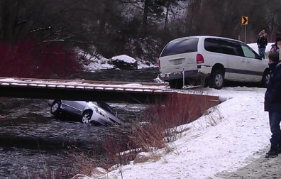 Image: A car in the Logan River in Utah