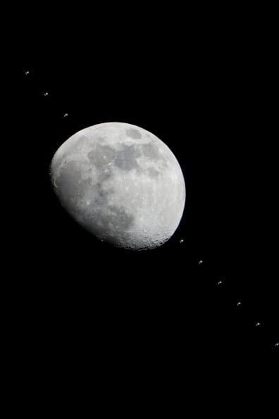 Image: Space station crossing face of moon
