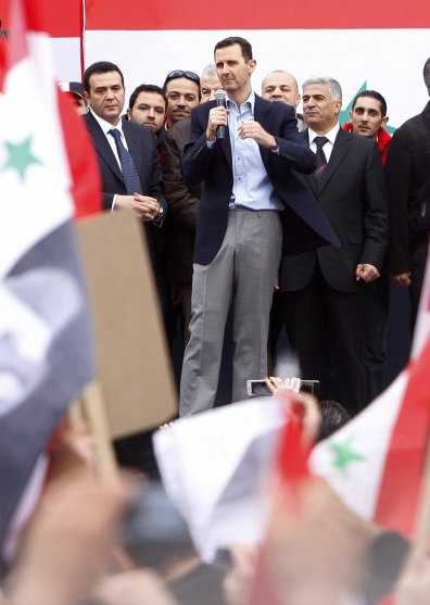 Image: Syrian President Bashar Assad, center, addresses supporters during a rally in Damascus, Syria