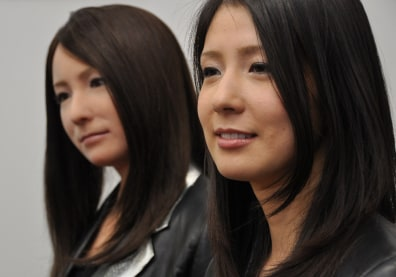 Image: Woman with look-alike robot