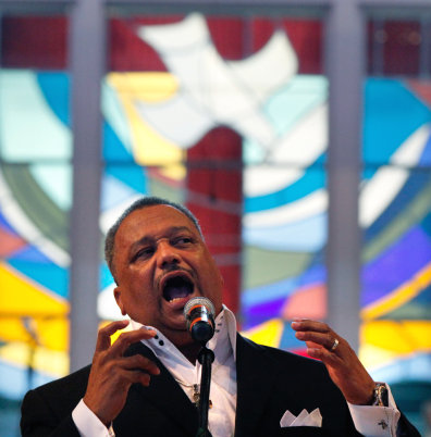Image: Rev. Fred Luter, pastor of the Franklin Ave. Baptist Church, delivers a sermon during Sunday Services at the Church in New Orleans, Sunday, June 3, 2012.