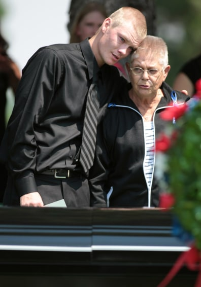 Image: Family members at Jonathan Blunk's grave