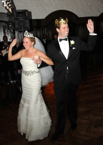 Image: Katie and Chris Dunlop wearing crowns on their wedding day