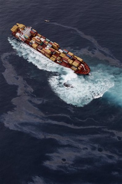 Image: The Liberian-flagged container ship Rena stuck aground on a reef off the coast of Tauranga, New Zealand.