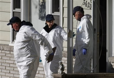 Image: Investigators leave the home of missing baby Lisa Irwin in Kansas City, Mo.