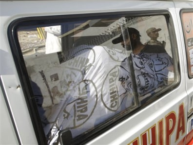 Image: The dead body of Moeed Abdul Salam is taken away in an ambulance in Karachi, Pakistan