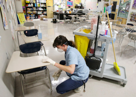 Image: Worker disinfects high school in Cibolo, Texas