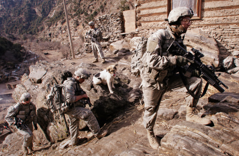 Image: Soldiers with U.S. Army's 6-4 Cavalry take up hilltop position during patrol near Combat Outpost Keating in eastern Afghanistan