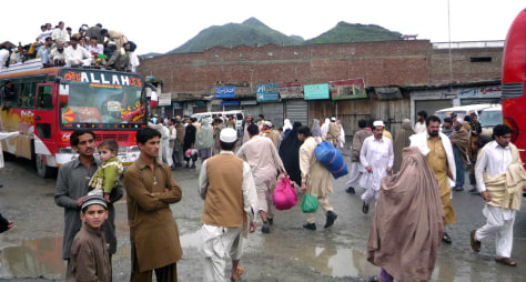 Image: Mingora residents flock to bus terminal