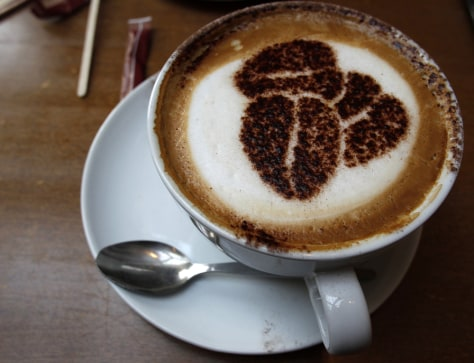 Image: A cup of cappuccino stands on a table at a branch of Costa coffee in Knutsford