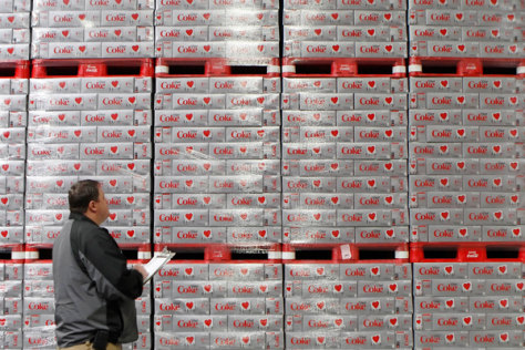 Image: Warehouse manager Chad Sadler inventories cases of Diet Coke in a warehouse at the Swire Coca-Cola facility in Utah.