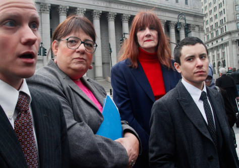 Image: Transgender people filing a lawsuit against New York City: Joan Marie Prinzivalli, second from left; Patricia Harrington, second from right; and Sam Berkley, far right, listen as attorney Noah Lewis, far left, speaks during a news conference in New York