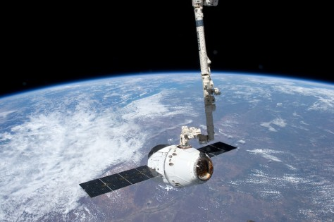 Image: SpaceX Dragon is grappled by robotic arm at space station
