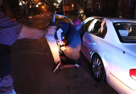 Image: A high speed pursuit following four suspected gang members ended with the Chicago Police gang unit questioning and arresting one of them on an outstanding warrant, on Chicago's West side.