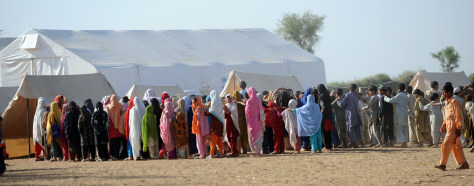 Image: Children line up for school assembly.