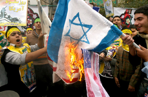 Image: Iranian students burn the U.S and Israel flags
