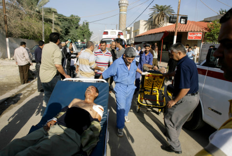 Image: Men injured in Iraq blast.