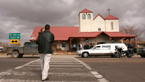 Image: A man arrives at the funeral of Vincent Romero at the St. John the Baptist church